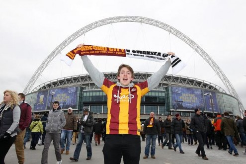 A `plucky'  Bantams fan celebrates not conceding 12 against Swansea