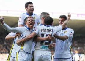 STEPHEN WARNOCK CELEBRATES SCORING  LEEDS PENALTY WITH TEAMMATES